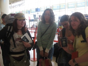 Clearly disappointed....traveling Eastern Europe in 2008, my American companions show disgust over our miniscule passports.